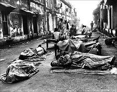 Homeless people asleep on the streets of Mumbai.