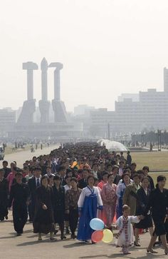 Kimjongilia Festival, North Korea. On this particular national holiday, the people of North Korean are required to visit the country's monuments.
