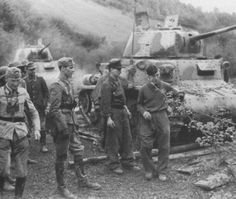 Several Carro-Armato M15/42 tanks with soldiers planning their next move.