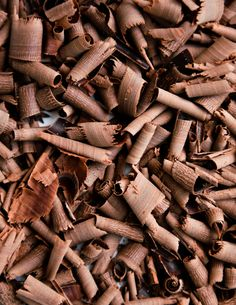chocolate shavings/ To make chocolate curls, heat a block of chocolate on high in the microwave for 5 - 10 seconds. The key is just to warm it very slightly but not to melt the chocolate. Run a vegetable peeler along the flat edges of the chocolate block to create the curls. Keep curls cool before use.