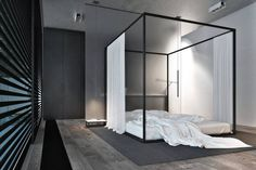 BED SERIOUS | Simple drapes frame this unfrivolous canopy in Kiev, Ukraine, designed by architect...