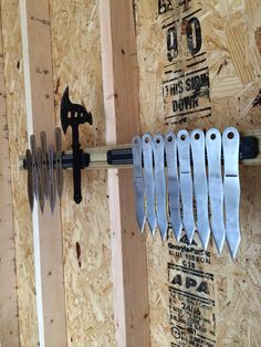 """Always keep your knife / axe throwing tools neatly organised - minimises training injuries. Plus, you're all set up for speed throwing, that is """"most knives in 20 seconds"""". Throwing Knife Target, Knife Throwing, Medieval Party, Shuriken, Man Caves, Magnetic Knife Strip, Knife Block, Blacksmithing, Axe"""