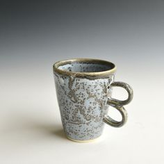 Handthrown Porcelain Coffee Mug With Double Ear by Kleiwerk on Gourmly
