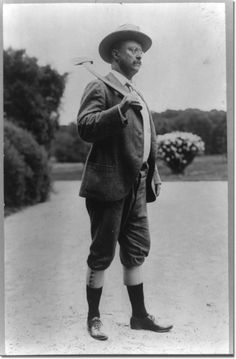 Burton, James, photographer - Theodore Roosevelt wearing knickerbockers and carrying an axe on his shoulder Print