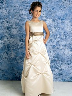 This exquisite flower girl dress is made of a piece of ivory satin draping over slender body shape in floor length. Front satin bodice with high neck is complemented by a champagne satin belt at waist. From waist runs down a skirt plunging down in vertical line of pick-up style. Fully lined, take this to wedding party and show your cute look.