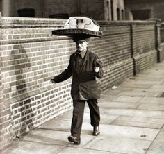 A muffin man making deliveries to households and announcing his presence with a hand bell, United Kingdom 1924, nd