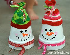 Snowmen out of clay pots...