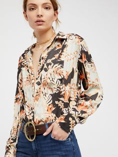 Under The Palms Buttondown   So silky buttondown featuring a bold garden-inspired print with a front pocket detail    * Rounded hem with side vents