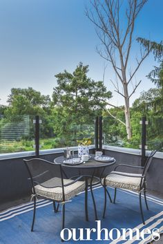 Seating for two on this raised deck with a dining area and glass railing-- not to mention that view!