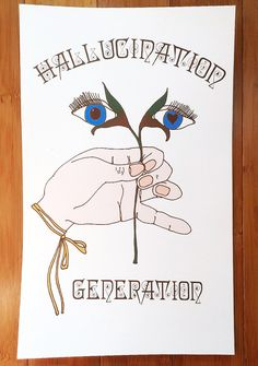 "Sugarhigh + Lovestoned Hallucination Generation Poster the only way to live, babe. Put yer lifestyle on display with this poster that features a white background with ""Hallucination Generation"" text across the top N' bottom and a hand holdin' a plant with some bloomin' blue eyez."