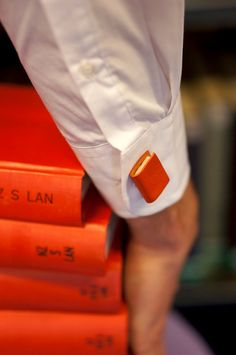Miniature Handcrafted Book Cuff Links For Him- Teeny Tiny, Miniature, Literature in Bright Orange. https://www.etsy.com/shop/ExLibrisJewellery