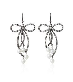 zsazsasitlist:  DESIGNER: Kenneth Jay Lane SEE DETAILS HERE: Large Gunmetal Crystal Bow Earring with Pearls