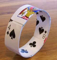 This bracelet was made from playing cards salvaged by an incomplete deck