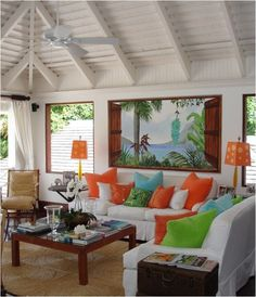 The lesson here is the versatility of a basically white palette.The tropical accents can easily be switched out to quickly transform the room.