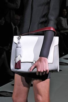 Anya Hindmarch Grey & white bag with 3 color tassel. #ss14