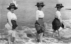 wading in the surf, 1900's