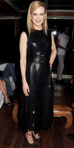 Nicole Kidman celebrated women in film wearing a leather Calvin Klein Collection dress, gold danglers and black heels.