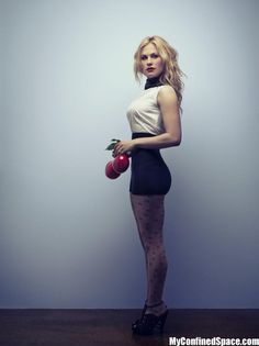 Anna Paquin holding red balls | MyConfinedSpace