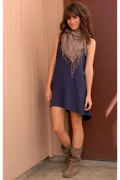 this is a great way to wear a scarf that has fringe or poms or any sort of dangling embellishment - over a simple dress it becomes jewelry.  So cute!