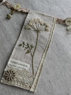 Embroidery Vintage gentlework: Botanical Bunting - vintage lace, buttons, book pages, embroidery - mixed media Vintage Embroidery, Embroidery Art, Cross Stitch Embroidery, Embroidery Patterns, Machine Embroidery, Vintage Lace, Vintage Buttons, Cross Stitches, Stitch Patterns