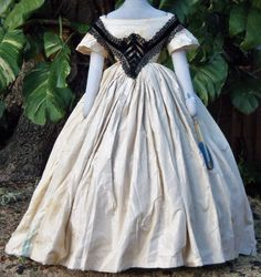 Evening dress with braces/bertha c. early 1860s. Made of Maltese or Bedforshire lace and insertion with black velvet and net. Purchased from the UK.