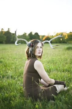 Girl with antlers in a field - Credits: Unknown