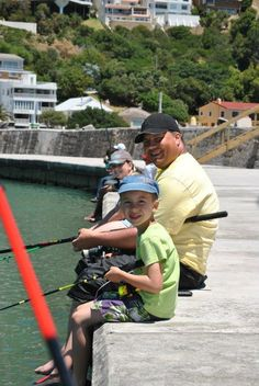 Fishing off the harbour wall in Gordons Bay