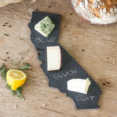 These slate cheese boards are available in all 50 state shapes. Would be perfect…