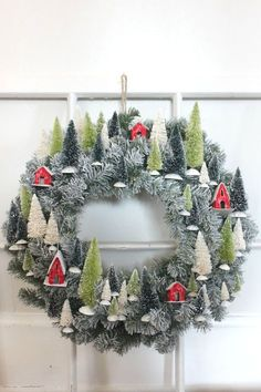 Mini Village Wreath | Bottle Brush Trees | Wreath Craft cute pin love this site http://www.bottlemeamessage.com great way to send a message http://www.upscaledogtoys.com