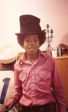 MICHAEL JACKSON caught wearing a crooked hat.