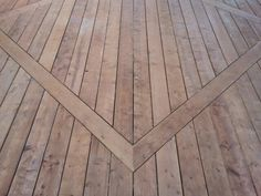 Creating a diamond inlay for this roomy new deck breaks up the long expanse of boards and allows for a joint-free deck. Done with Sienna brown pressure treated lumber and GRK hidden fasteners