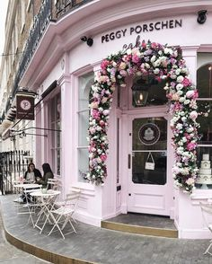 The floral covered front door of PeggyPorschen in Belgravia, London. Serves cakes and tea!