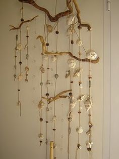 A driftwood and seashell hanging decoration could also make a chandelier with mason jars for tea lights...