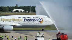 """Welcome back! The Boeing 747-8 """"Potsdam"""" with the German soccer world champions 2014 has landed at airport Berlin-Tegel."""
