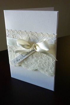 Lace invitation and bow :) @Ingrid Pinto El Guindy