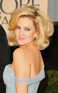 Drew Barrymore finds massive volume on her golden blonde locks with a teased hairstyle. Find your own perfect hair color blended just for you at www.eSalon.com