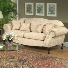 Vintage-inspired loveseat with ivory floral upholstery and cabriole legs.  Product: LoveseatConstruction Material: Engineered wood, polyester and foamColor: Madison strawFeatures:  Leggett and platt sinuous springsMade in the USA Dimensions: 41 H x 70 W x 38 D