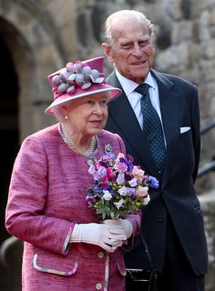 Queen Elizabeth II and the Duke of Edinburgh during a visit to Stirling Castle, as she marked 70 years since being appointed Colonel-in-Chief of the Argyll and Sutherland Highlanders. via @AOL_Lifestyle Read more: https://www.aol.com/article/lifestyle/2017/07/06/queen-pony-flowers-scotland/23019720/?a_dgi=aolshare_pinterest#fullscreen
