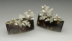 The side elements of a tiara of oak-leaves and acorns, c 1855, mounted on tortoishell combs.  Much Victorian jewellery was convertible to other forms - as well as tiara and combs, all of the (3) elements of the tiara can be combined to make a large corsage brooch.   Silver and gold, open-back, set with diamonds; the case is extant, labelled Hunt & Roskell, New Bond Street