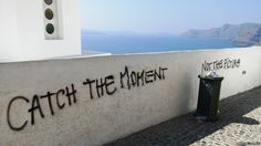 """Graffiti in Santorini... """"Santorini in Greece is one of the most photogenic tourist destinations in the world. But this graffiti had a point. Maybe we should put our cameras down a bit more?"""""""