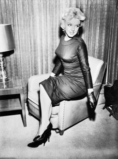 Monroe in 1956 at Idlewild Airport (now JFK International Airport) just before heading to Los Angeles to work on a new film.