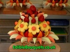 http://www.ediblebouquets.co.uk - An edible bouquet or arrangement of fresh fruit, made to order and arranged and presented like a bouquet of flowers but in a basket. Or , chocolate dipped strawberries and chocolate covered strawberries or apple presented as a boxed gift. Edible Bouquets, bouquets, arrangements - Fresh fruit  with or without cho...