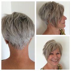 Gray hair with low lights and an asymmetirc razor cut bob.