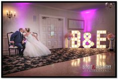 Bride and Groom kiss at the Essex Room with large illuminated letters! #essexroom #benoit&mccarthyphotography #illuminatedlettes #weddingphotography #northshoreweddingphotography