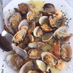 Do you like  shellfish  mariscos? These scrummy  clams  almejas were served with  Spanish ham and mushrooms  jamón serrano y champiñones  #almejas #clams #spanishfood http://ift.tt/2vkQICT