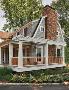 pergolas on decks porch in Exterior Traditional with gambrel roof Cape Cod style