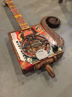 Funhouse cigarbox guitar with pick up built by Michael Ballerini at rustbelt CBG's.