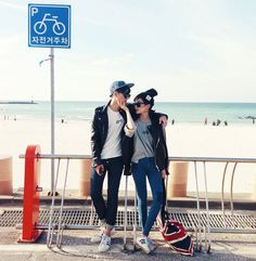 beach please Cute couple in street wear style by the beach.