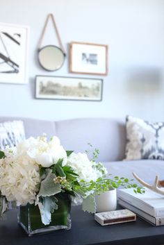 simple gallery wall and coffee table styling