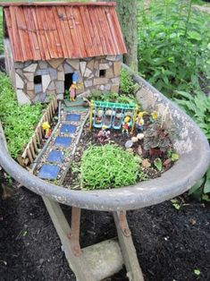 Dick makes his own fairy houses..here the well-known Simpson family took up residence in an old rusty wheel barrow